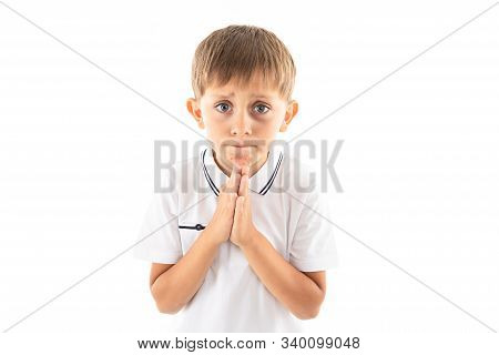 Boy With Bangs In A White T-shirt Asks For Something On A White Background With Copy Space.