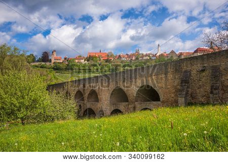 Medieval stone double bridge over Tauber at Rothenburg ob der Tauber, Bavaria, Germany, Europe, one of the most popular travel destination on Romantic Road touristic route