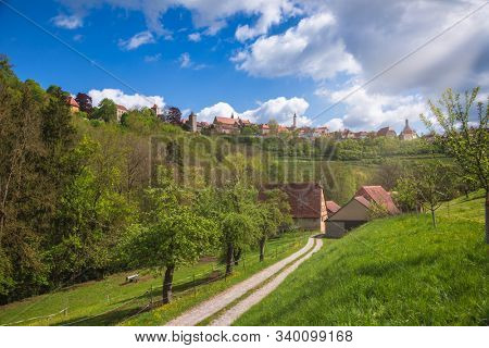 Scenic skyline of Rothenburg ob der Tauber, Bavaria, Germany, Europe, one of the most popular travel destination on Romantic Road touristic route as seen from the Tauber river valley