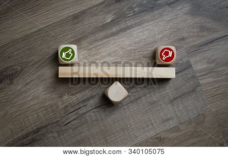 Cubes Dice With Thumbs Up And Down On Wooden Background