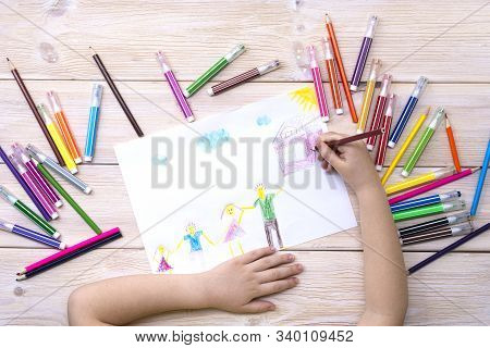 A Child Draws A Birthday Card With His Family. Drawing Made By A Child With Colorful Felt-tip Pens A