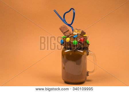 Chocolate Milkshake With Whipped Cream, Cookies, Waffles, Served In Glass Mason Jar.