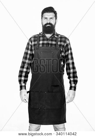 Apron Protecting His Clothing From Splatters. Master Cook In Cooking Apron With Pockets. Bearded Man
