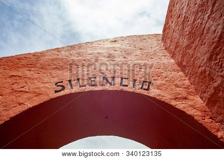 The Arches At The Monastery Of Saint Catalina In Arequipa, Peru. Arch Of Red Color, On It An Inscrip