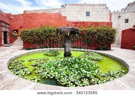 Fountain In Monastery Saint Catalina, Arequipa, Peru. In The Center Is A Fountain, Followed By A Hou