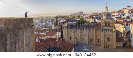 Coimbra, Portugal - Sept 6th 2019: Mature Tourist Man Observing City From Viewpoint. He Holds A Map