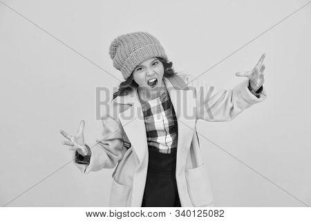 Rrrrr. Little Schoolchild Roar Frightfully. Angry Little Kid On Yellow Background. Unhappy Little Gi