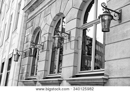 Building Facade. Old Building Exterior With Windows And Lanterns. Historic Building Structure. Archi