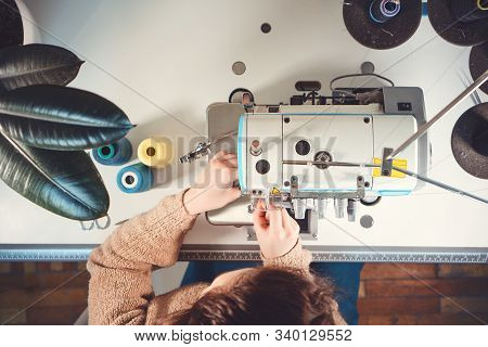Workplace Of Seamstress. Top View. Tailor Works With Sewing Machine.