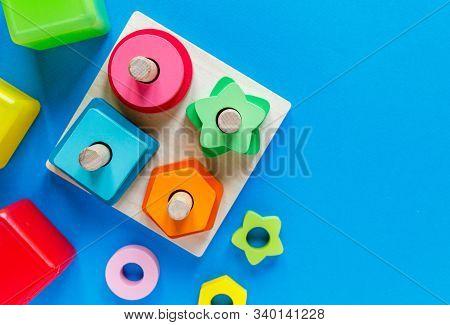 Wooden Kids Toys On Colourful Paper. Educational Toys Blocks. Toys For Kindergarten, Preschool Or Da