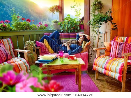 woman enjoying her comfortable terrace poster