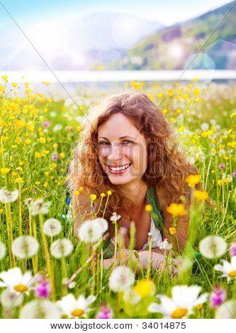 sweet girl in a meadow full of dandelions
