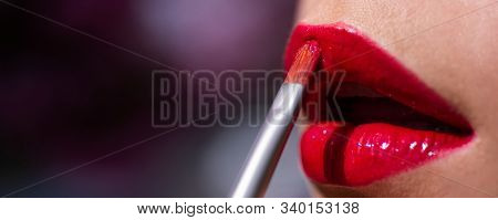 Closeup Sexy Lips With Lipstick. Beautiful Young Woman Painting Red Lipstick On Lips. Young Woman Ap