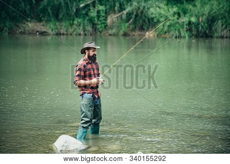Male Fishing On The Lake. Relax In Natural Environment. Good Profit. Carry On Fishing. Man Relaxing