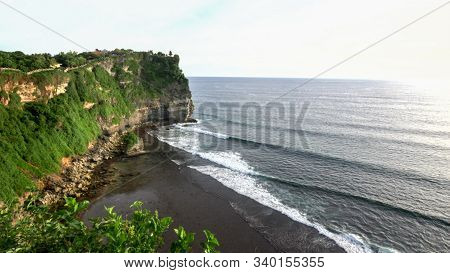 Afternoon Shot Of The Cliffs And Surf At Uluwatu Temple On Bali