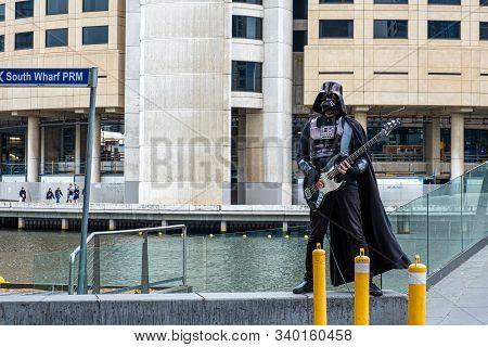 Melbourne, Australia - December 14, 2019:  Street Artist Dressed As Darth Vader Playing Electric Gui