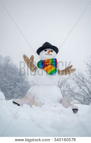 Snowman In A Scarf And Hat. Happy Funny Snowman In The Snow. Winter Background With Snowflakes And S