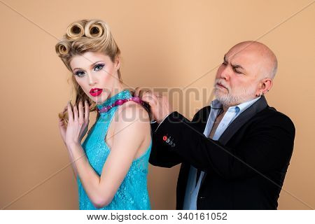 Crafty Blonde Woman Want To Marry Rich Sugar Daddy To Get His Money. Difference Of Ages Concept. Cou
