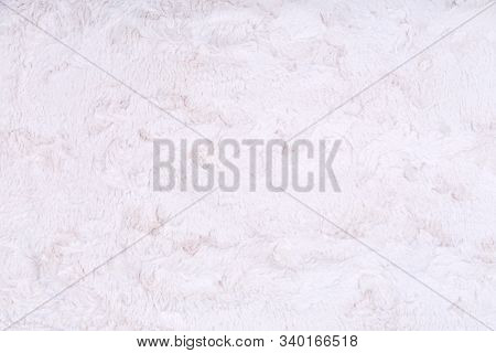 White Vegan Faux Fur Texture Background. Eco Friendly Trendy Alternative To Natural Fur. Modern Mate
