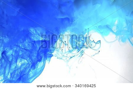 Watercolor Ink In Water. Blue Magic Abstract Background.