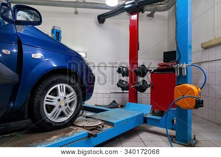Blue Car Front Wheel View Stands On The Stand Wheel Alignment Convergence Of The Car During Regular