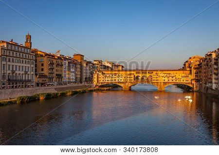 Ponte Vecchio Bridge With Reflection At Sunset In Florence On The Arno River
