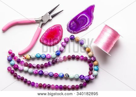 Colored Beads. Purple, Pink, Rose Gemstone Beads And Agate Druses For Jewelry Making On White Backgr