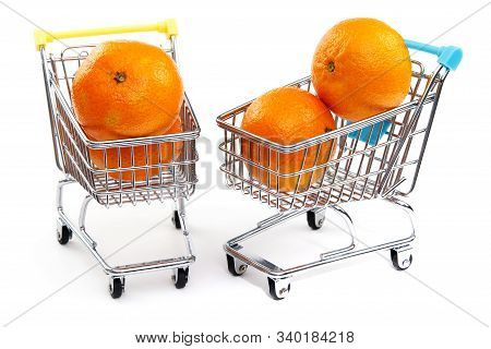 A Mandarin In Shopping Cart Isolated On White Background. Ripe Tasty Tangerines In Shopping Cart. Ma