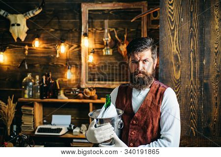 Servant. Handsome Barman. Handsome Bearded Barman With A Long Beard And Mustache Has Stylish Hair. W