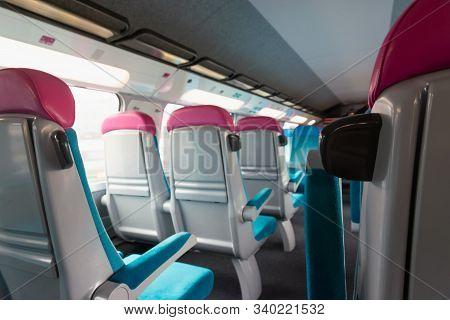 Train Interior. View On Train Interior. Modern Train Seats. Empty Train Of Passengers. Unoccupied Se