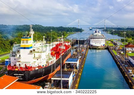Panama Canal, Panama - December 7, 2019: A Cargo Ship Entering The Miraflores Locks In The Panama Ca