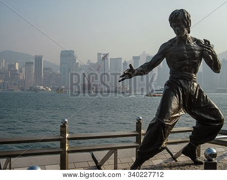 Hong Kong, January, 2013 - Bruce Lee Statue On The Avenue Of Stars At The Victoria Harbour Waterfron