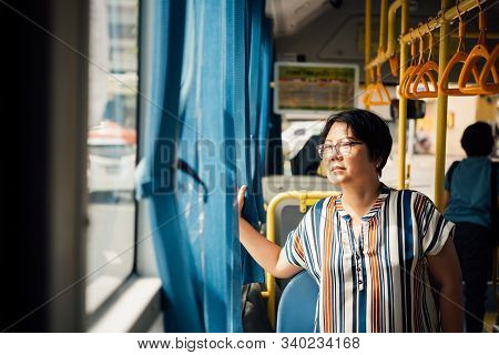 Asian Woman Travel By Passenger Bus In City