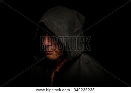 Portrait Of A Courageous Warrior Wanderer In A Black Cloak. Historical Fantasy. Halloween