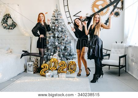New Year Eve 2020 Party. Celebrating Of New Year. Three Happy Young Girls With Golden Baloons 2020 C