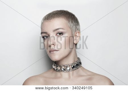 Beautiful woman with short haircut and vintage rhinestone chocker