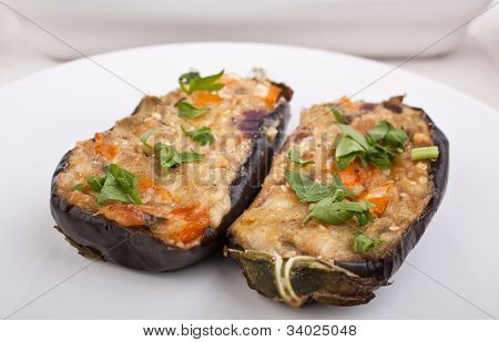 two stuffed with cheese and mushrooms aubergines