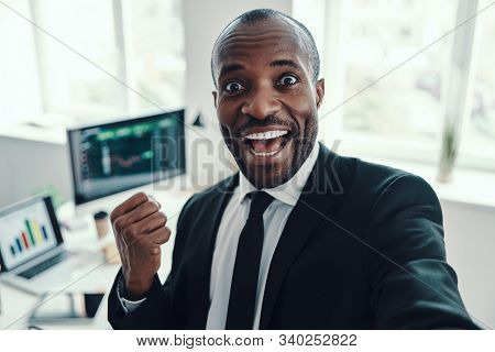 Self Portrait Of Happy Young African Man In Formalwear Looking At Camera And Smiling While Working I