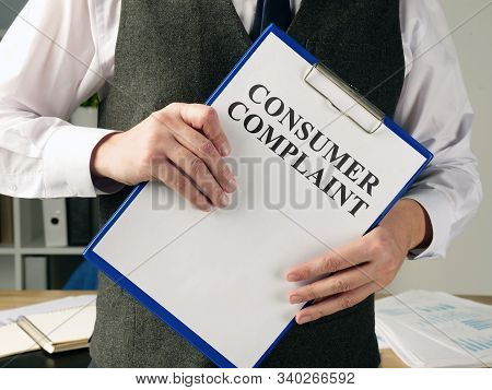 Manager Is Holding Consumer Complaint Application Form.