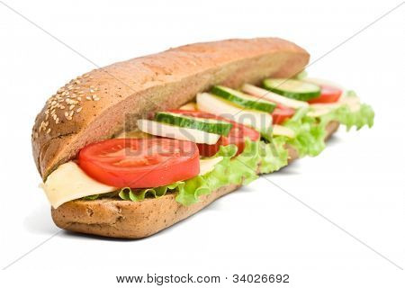 long whole wheat vegetarian baguette sandwich with swiss cheese, lettuce, onions, tomatoes and cucumbers