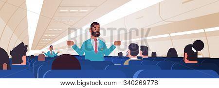 Steward Explaining Instructions For Passengers African American Male Flight Attendants In Uniform Sh