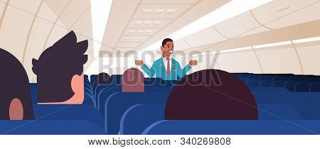Steward Explaining Instructions For Passengers African American Male Flight Attendant In Uniform Sho