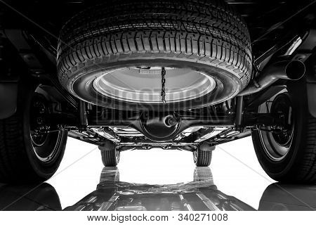 Car Suspension, Chassis And Spare Tire On Black And White Tone