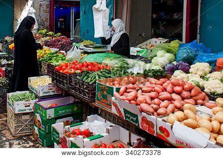 Jerusalem, Israel, 12/2018 Muslim Arab Woman In Hijab Shopping At Vegetable Fruit Market Or Street S