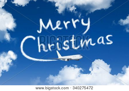 Happy Merry Christmas Concept. Drawing By Airplane Vapor Contrail In Sky