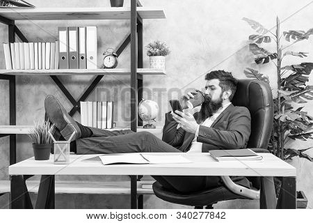Coffee is pledge of successful negotiations. Caffeine addicted. Mobile call. Start day with coffee. Coffee relaxing break. Boss enjoying energy drink. Man bearded businessman hold cup and smartphone. poster