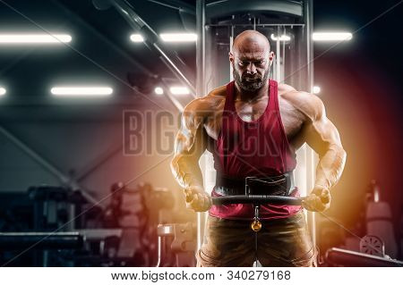 Bodybuilder Handsome Strong Athletic Man Pumping Up Biceps