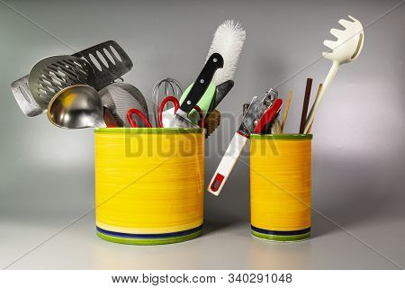 Two Ceramic Vases With Kitchen Utensils, Skimmers, Ladles, Can Openers, Scissors