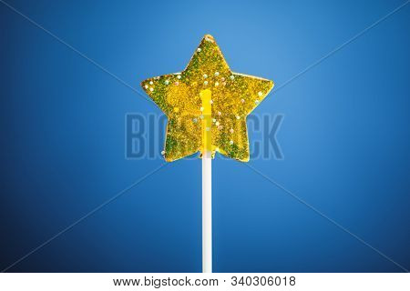 yellow star candy, blue background