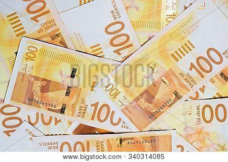 Israeli Money Stack Of The New Israeli Money Bills (banknotes) Of 100 Shekel. New Israeli Shekel Ser